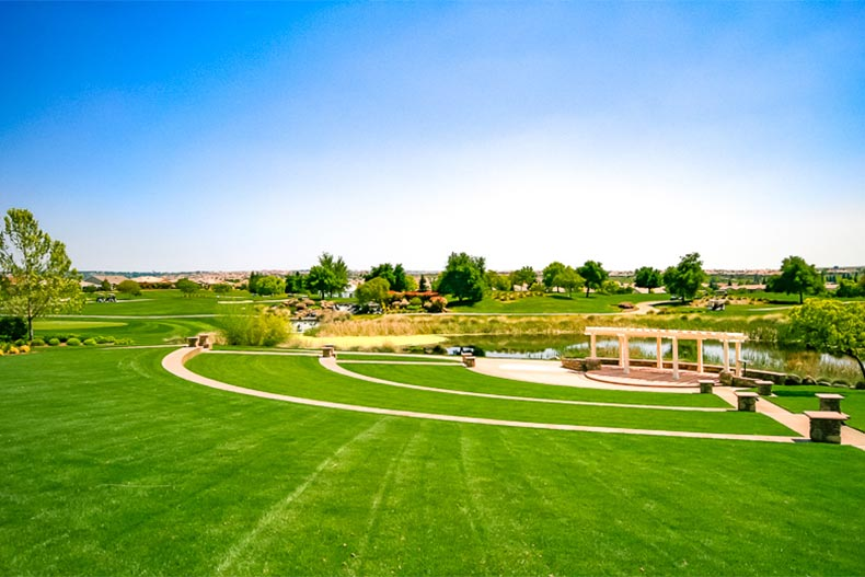 Well-landscaped field with pond and greenspace in Sun City Lincoln Hills