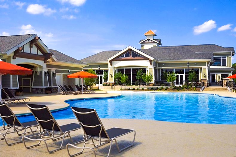 Outdoor pool and lounge chairs near Sun City Peachtree clubhouse
