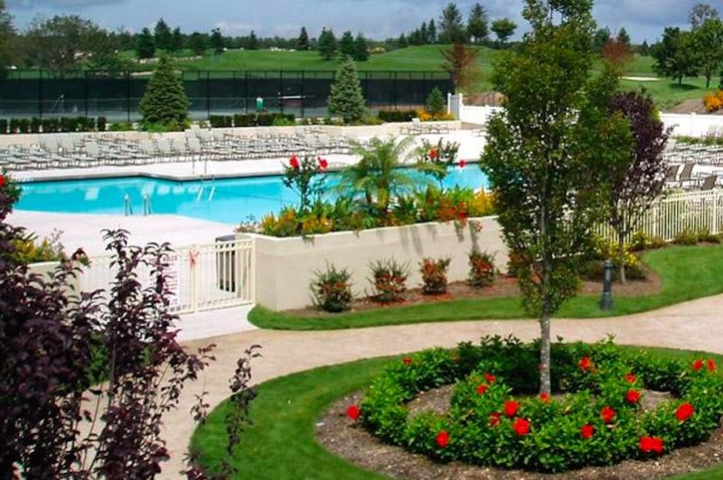 Outdoors, a pool and patio helps everyone at The Greens at Half Hollow enjoy the warmer months.