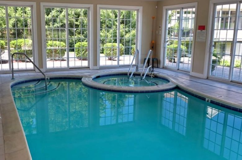 The indoor pool and spa lets residents work out and relax any time of year.