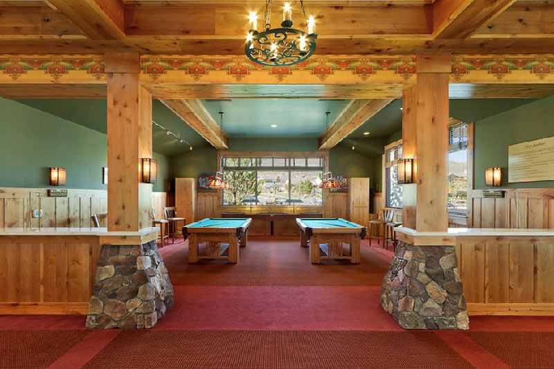 interior of aspen lodge clubhouse with billiards table and wood panels