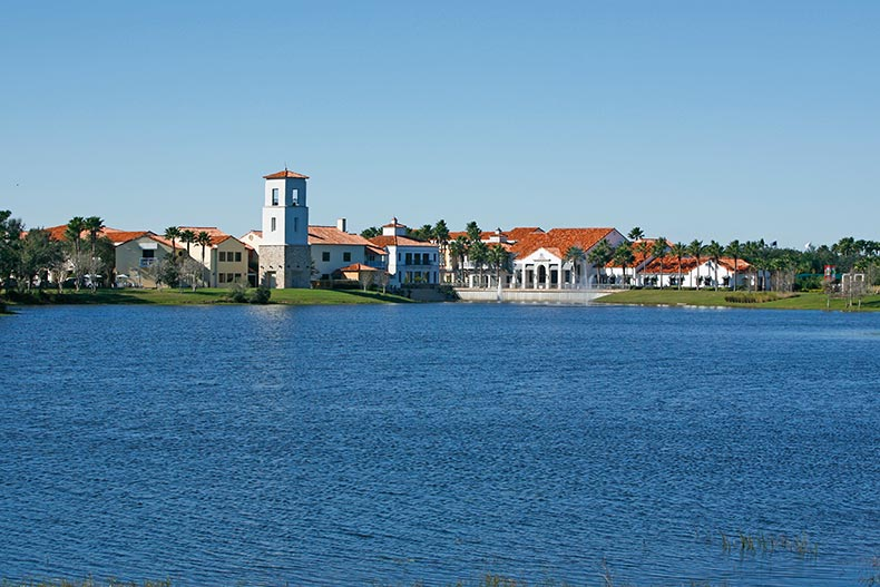View across a picturesque lake of Solivita in Kissimmee, Florida