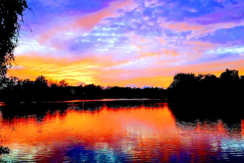A late evening sunset reflected over a calm lake in South Bend, Indiana