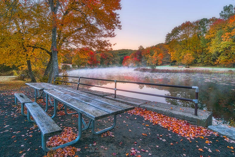 Photo of a bench and lake at Southford Falls State Park in Southbury, Connecticut