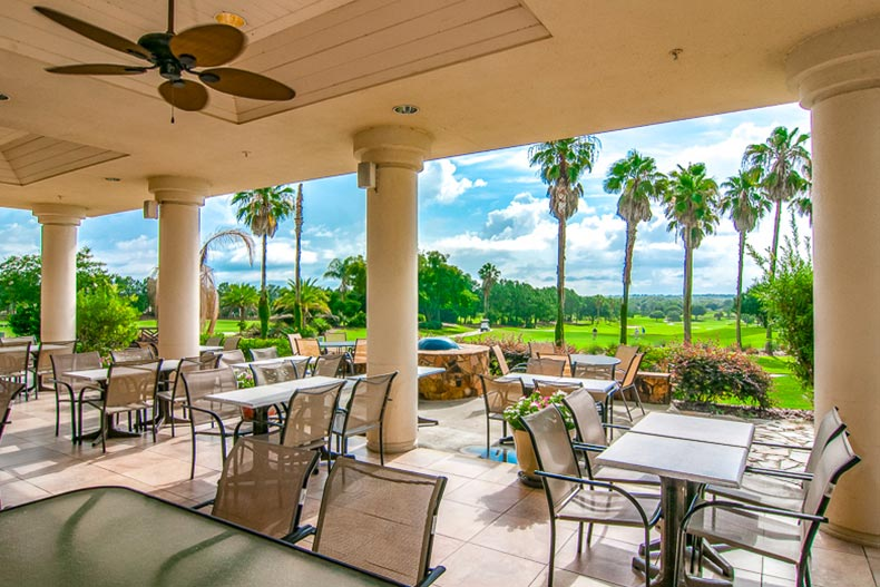Tables and chairs on the outdoor patio at Spruce Creek Country Club in Summerfield, Florida