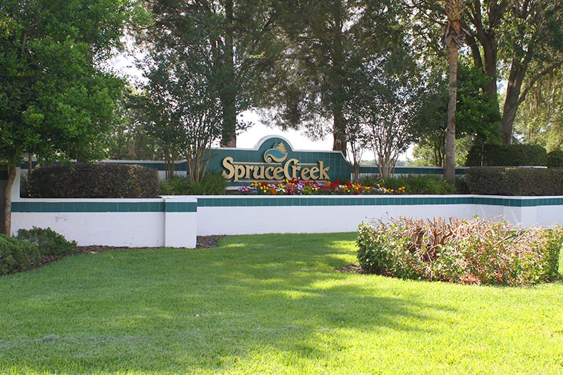 Greenery surrounding the community sign for Spruce Creek South in Summerfield, Florida