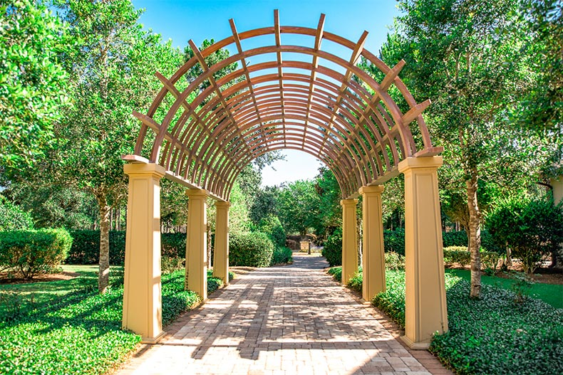 An artistic archway over a garden pathway at Stone Creek in Ocala, Florida
