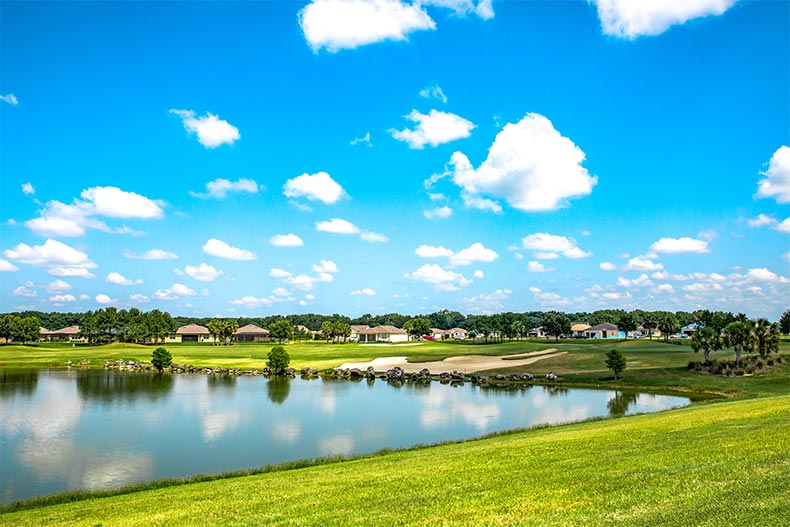 A calm pond beside a golf course and homes in Stone Creek in Ocala, Florida