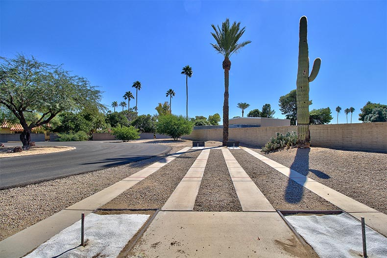 Desert landscaping and horseshoe pits at Sun City in Arizona