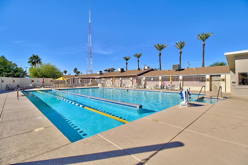 Blue sky over the outdoor lap pool at Sun City in Sun City, Arizona