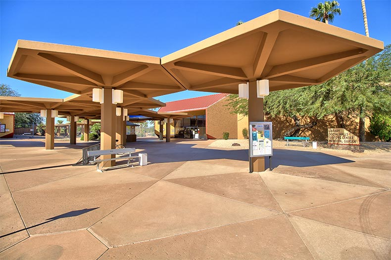 Outdoor social spaces with shade and benches at Sun City in Arizona