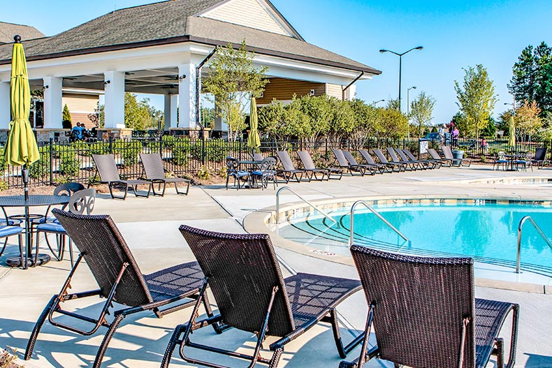 An outdoor pool and patio at Sun City Carolina Lakes in Indian Land, South Carolina