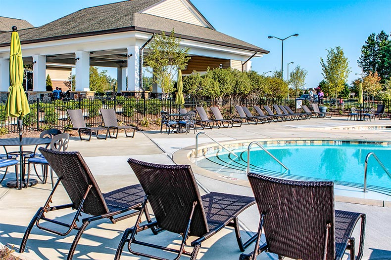 The outdoor pool, spa, and patio at Sun City Carolina Lakes in Indian Land, South Carolina