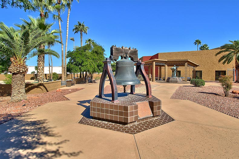 A historic bell on a walkway at Sun City in Arizona
