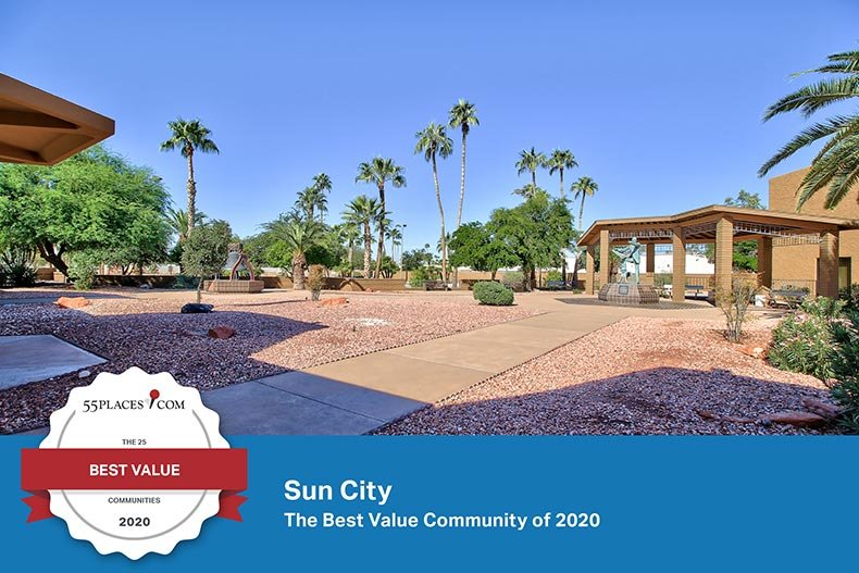 """Best Value Active Adult Communities of 2020"" badge over trees surrounding a picturesque pond at Sun City in Arizona"