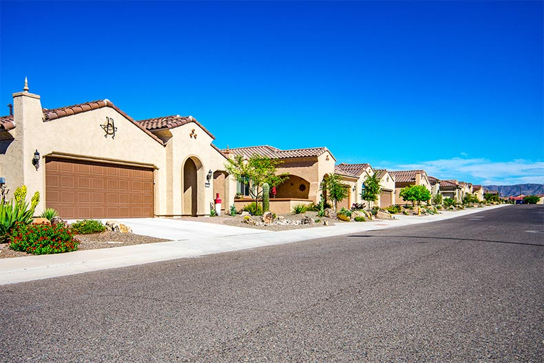 A row of homes down a street at Sun City Festival in Buckeye, Arizona