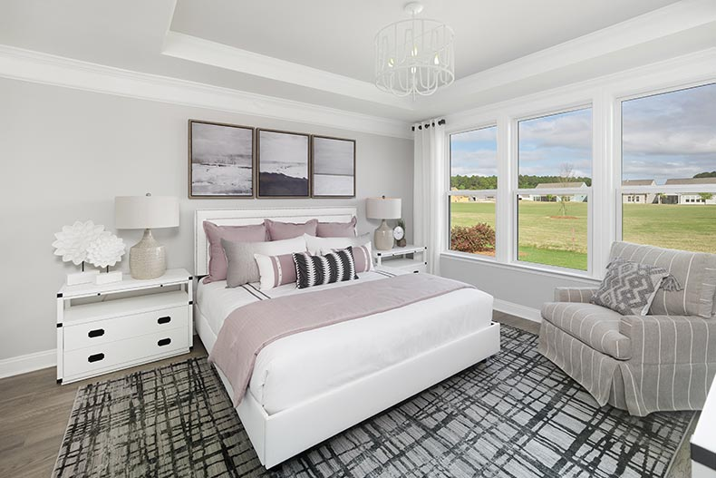 Interior view of a bedroom in a model home at Sun City Hilton Head in Bluffton, South Carolina