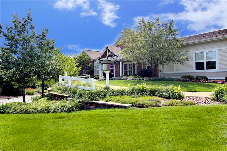 Blue sky over a property at Sun City Huntley in Huntley, Illinois with a green, manicured lawn