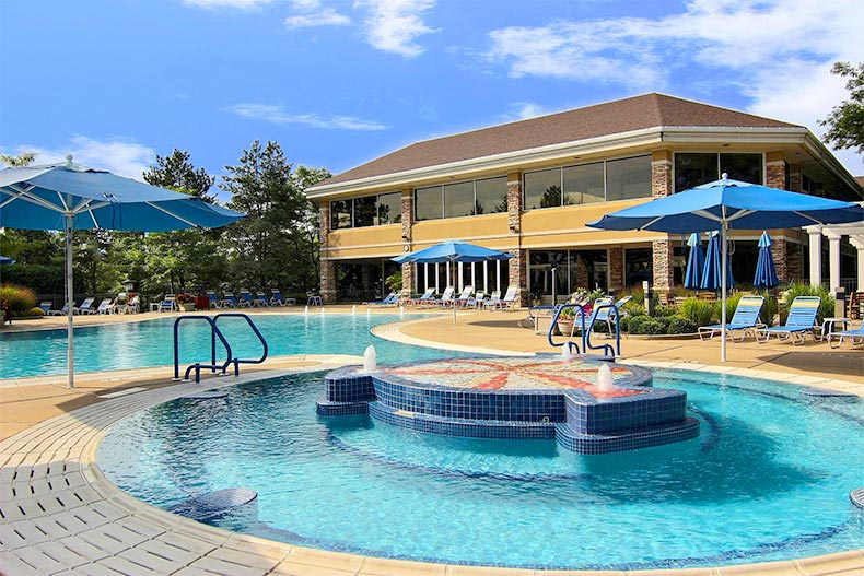 Blue sky over the outdoor pool and jacuzzi at Sun City Huntley in Huntley, Illinois
