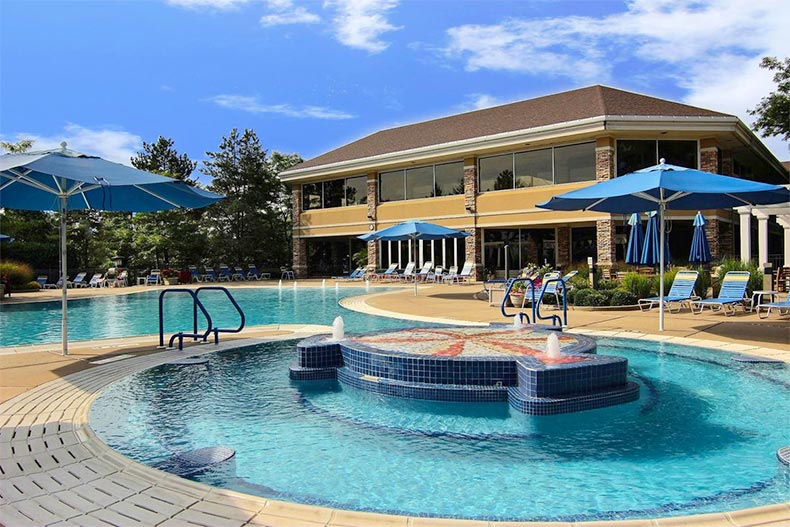 The outdoor pool and patio at Sun City Huntley in Huntley, Illinois
