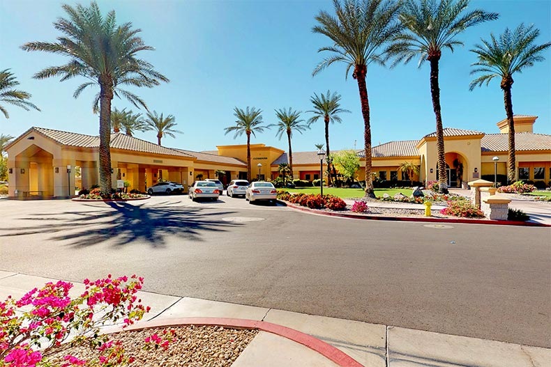 Palm trees surrounding the main entrance to Sun City Palm Desert in Palm Desert, California