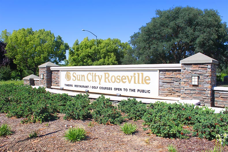 Greenery surrounding the community sign for Sun City Roseville in Roseville, California