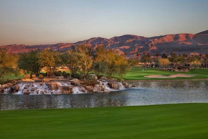 A picturesque waterfall and pond on the golf course at Sun City Shadow Hills in Indio, California