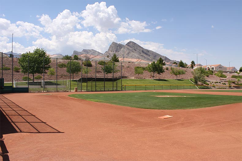 A softball field with mountains in the background at Sun City Summerlin in Las Vegas, Nevada