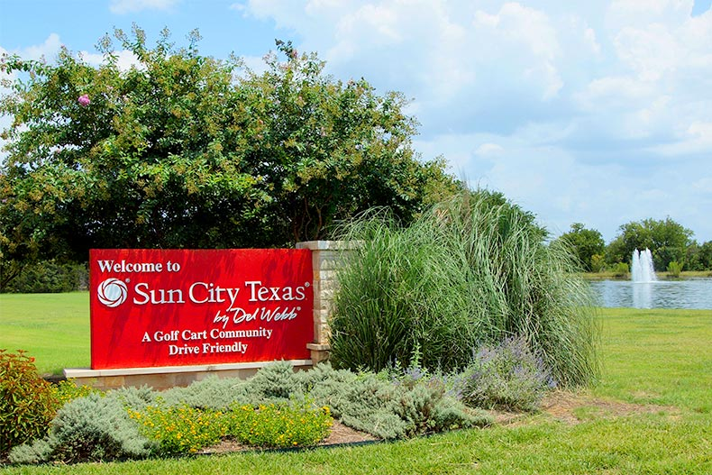 Manicured landscaping surrounding the sign for Sun City Texas in Georgetown, Texas