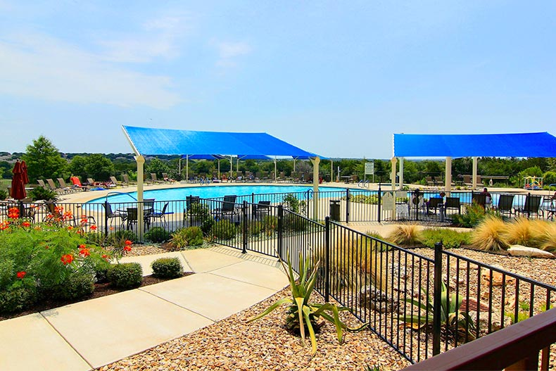 An outdoor resort-style pool and patio at Sun City Texas in Georgetown, Texas