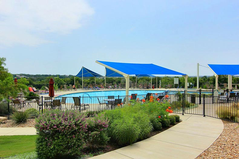 An outdoor pool and patio at Sun City Texas in Georgetown, Texas