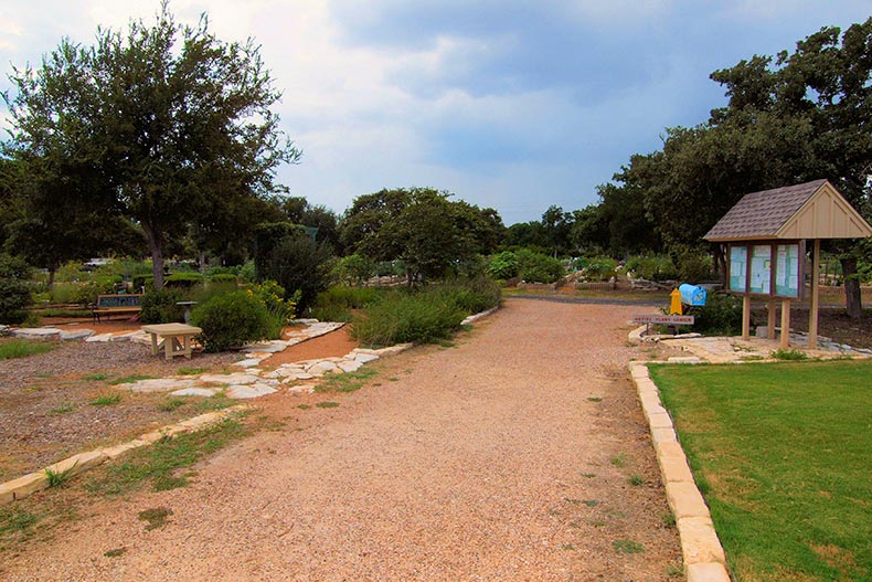 A dirt path beside the community garden at Sun City Texas in Georgetown, Texas