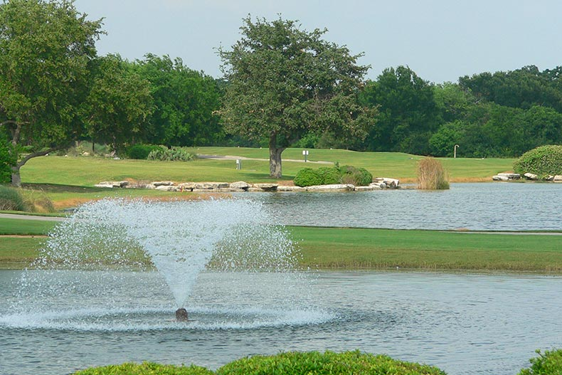 Scenic ponds and trees dotting a golf course at Sun City Texas in Georgetown, Texas