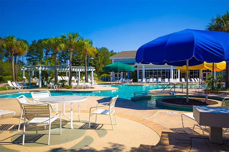 Lounge chairs and umbrella near Sun City Hilton Head pool