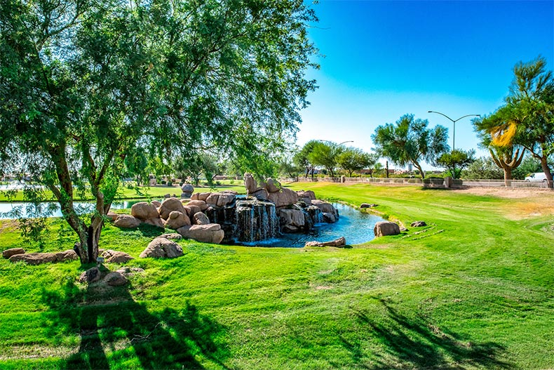 Landscaped greenery surrounding a water feature at Sunland Springs Village in Mesa, Arizona
