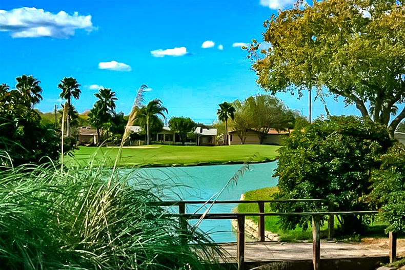 The golf course and water feature at Sunshine Country Club Estates.