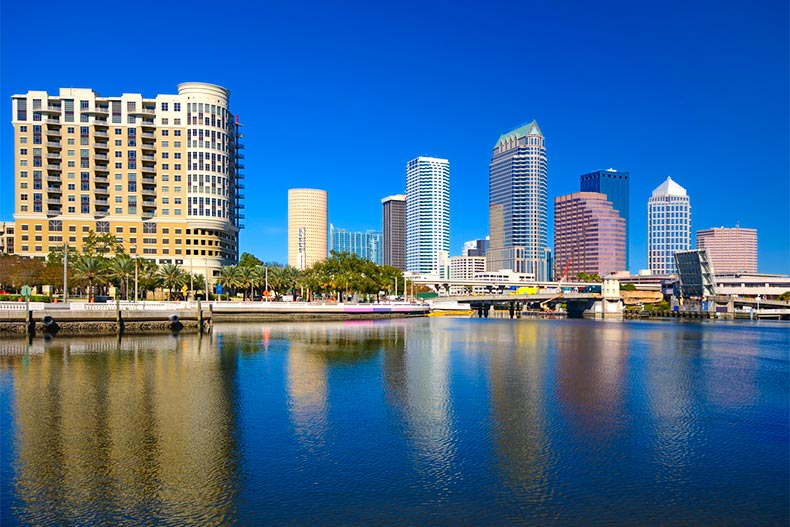 High rises and skyscrapers reflecting onto the water of Tampa Bay in Florida
