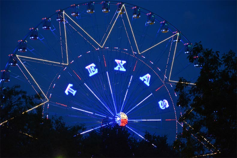 Lit up Ferris Wheel at night during the Texas State Fair