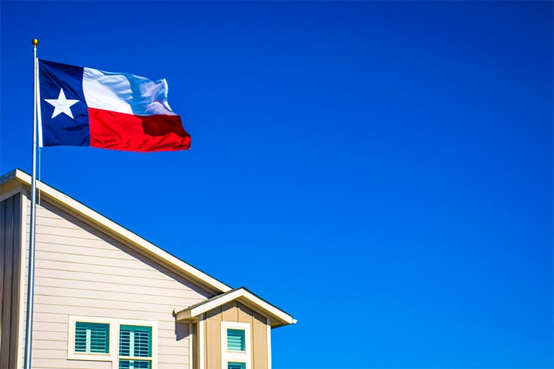 Flag of Texas flying in front of a new construction home near Austin, Texas