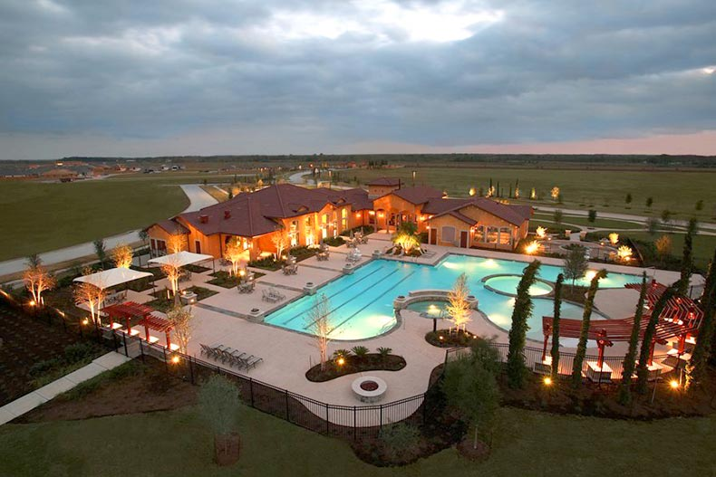 Aerial nighttime view of the amenities at The Village at Tuscan Lakes in League City, Texas