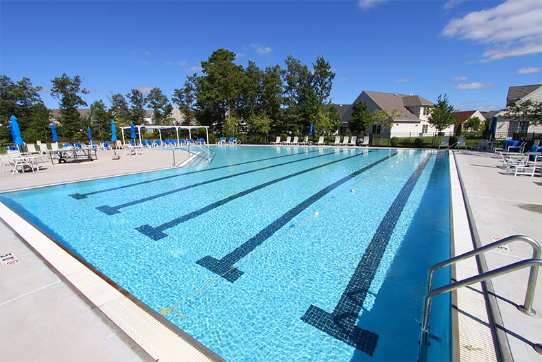 The outdoor pool and patio at The Village Grande at English Mill in Egg Harbor Township, New Jersey