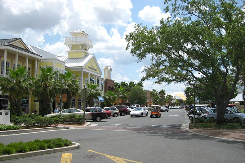 View down a tree-lined main street at The Villages in Florida