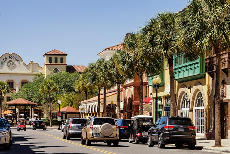 Palm trees and shops lining the street in The Villages, Florida