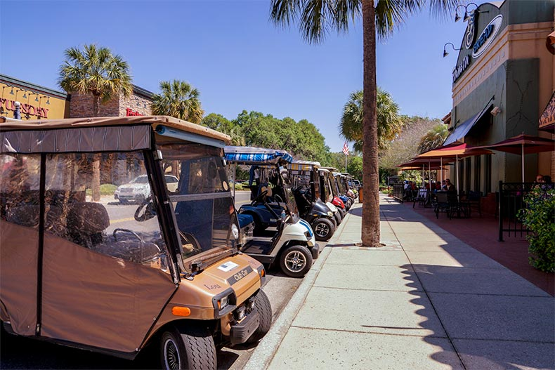 Golf carts lined up along the street in The Villages, Florida