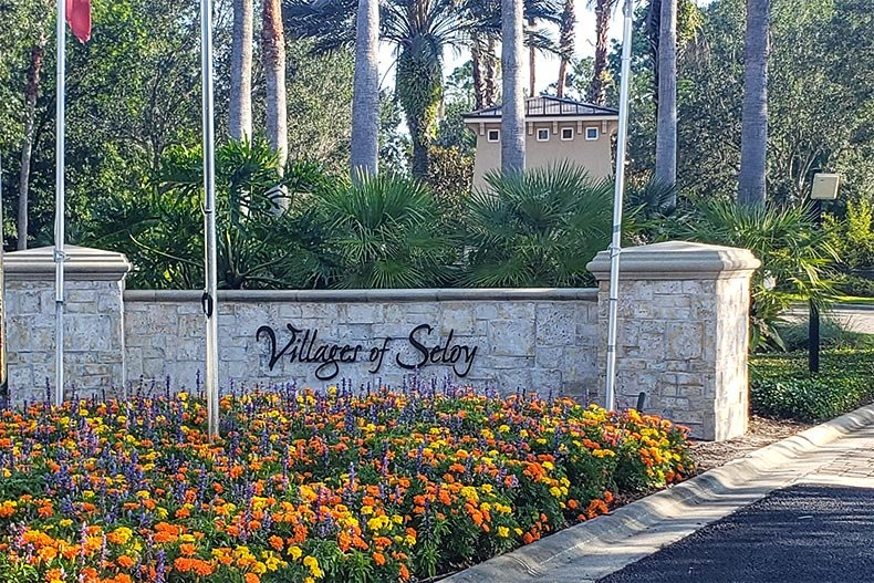 Flowers in front of the community sign for Villages of Seloy in Saint Augustine, Florida