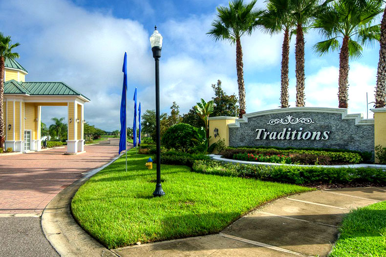 The entrance sign and landscaping at Traditions at Lake Ruby in Winter Haven, Florida.