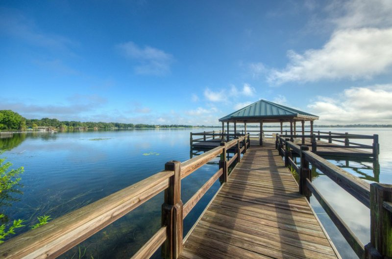 A lakeside gazebo is just one of the beautiful amenities available to  residents of Traditions at Lake Ruby.