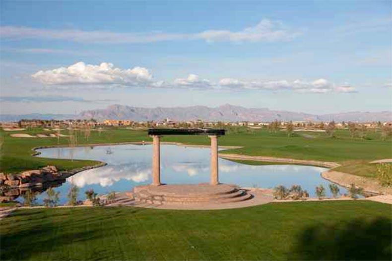 An outdoor pavilion beside a pond in Trilogy at Encanterra in Queen Creek, Arizona