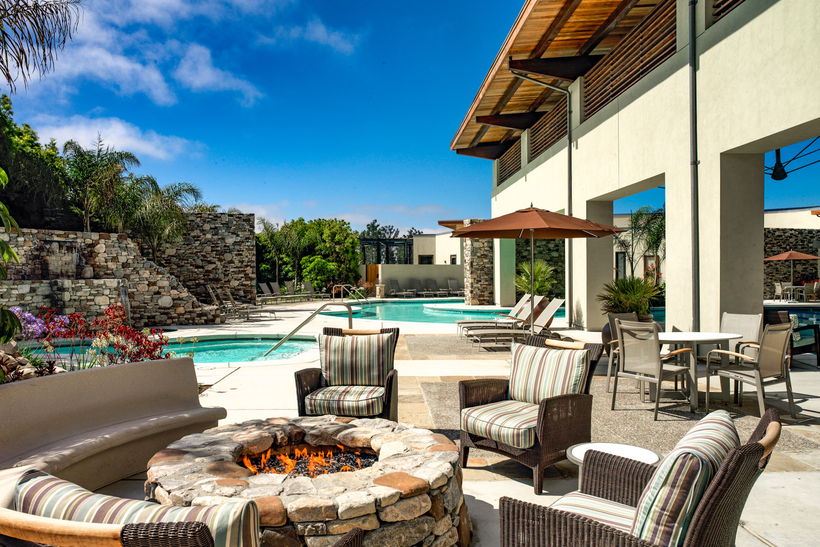 The outdoor pool, spa, patio, and fire pit at Trilogy at Monarch Dunes in Nipomo, California
