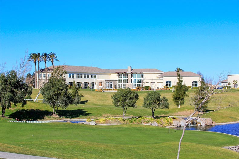 Exterior view of the clubhouse and grounds at Trilogy at Rio Vista in Rio Vista, California